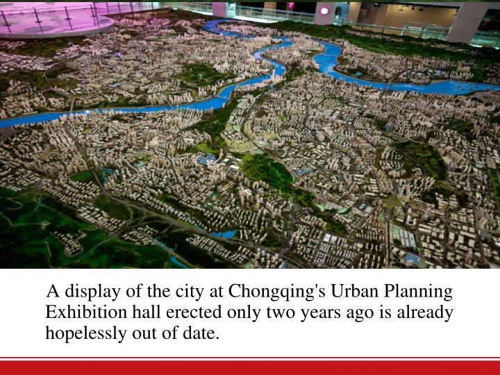A display of the city at Chongqing's Urban Planning Exhibition hall erected only two years ago is already hopelessly out of date.