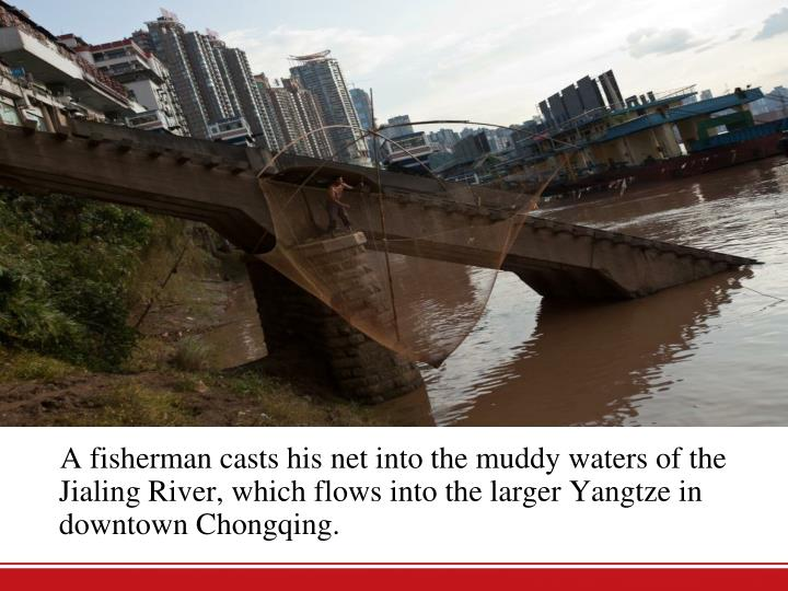 A fisherman casts his net into the muddy waters of the Jialing River, which flows into the larger Yangtze in downtown Chongqing.