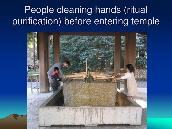 People cleaning hands (ritual purification) before entering temple