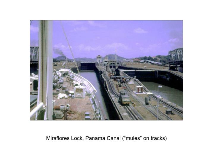 "Miraflores Lock, Panama Canal (""mules"" on tracks)"