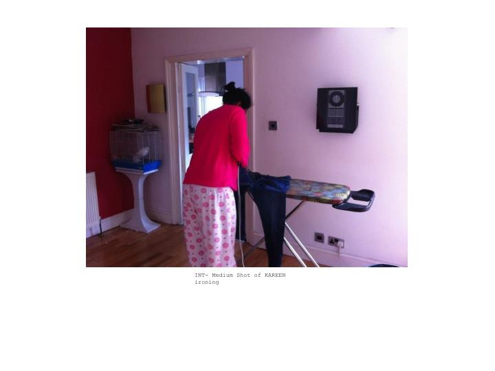 INT- Medium Shot of KAREEN ironing