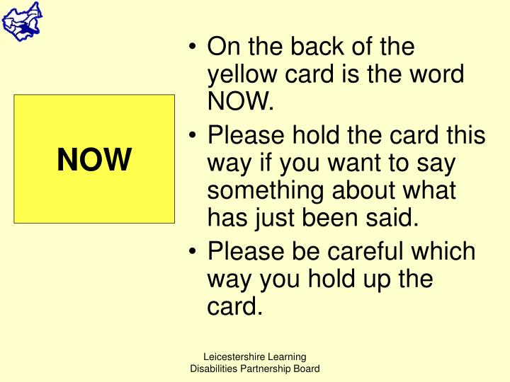 On the back of the yellow card is the word NOW.