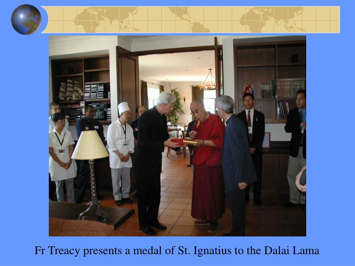Fr Treacy presents a medal of St. Ignatius to the Dalai Lama