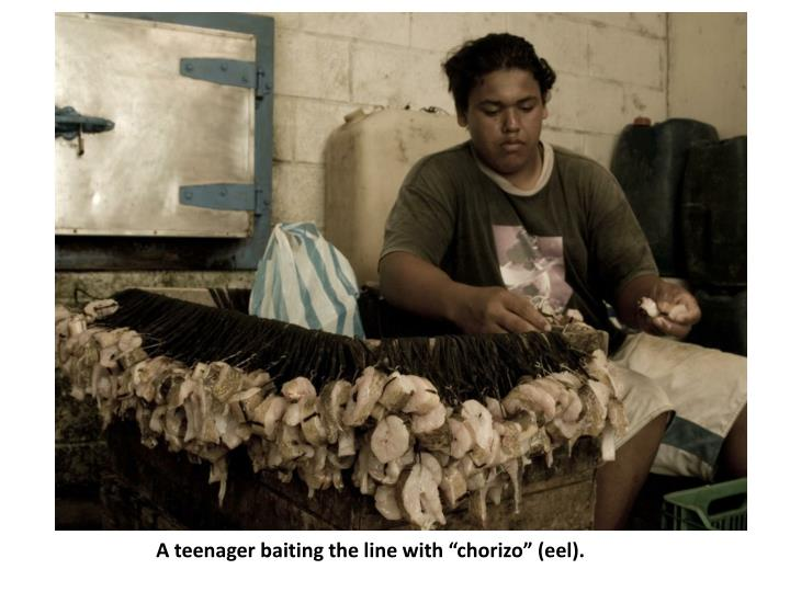 "A teenager baiting the line with ""chorizo"" (eel)."