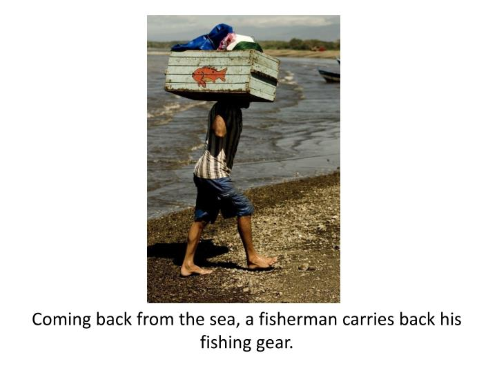 Coming back from the sea, a fisherman carries back his fishing gear.