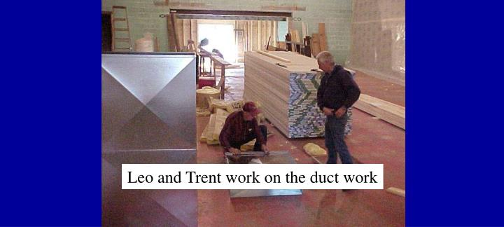 Leo and Trent work on the duct work