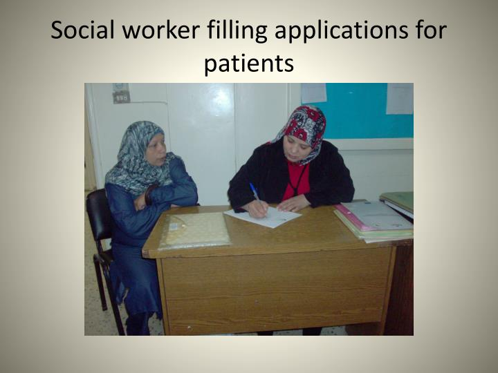 Social worker filling applications for