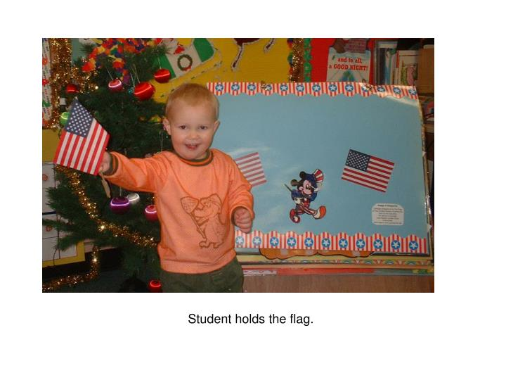 Student holds the flag.