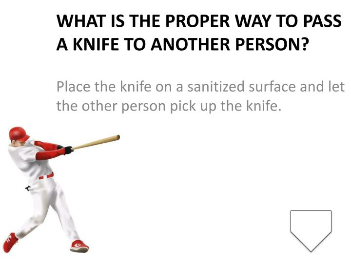 What is the proper way to pass a knife to another person?