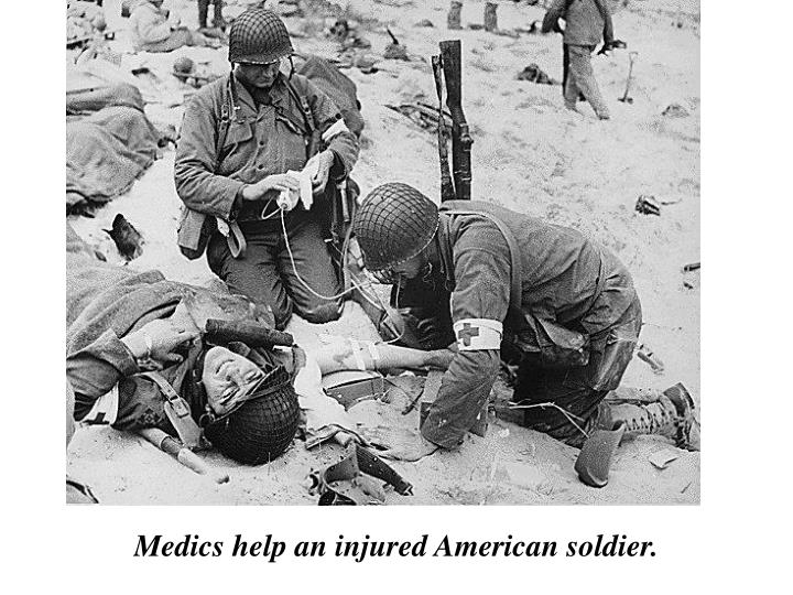 Medics help an injured American soldier.