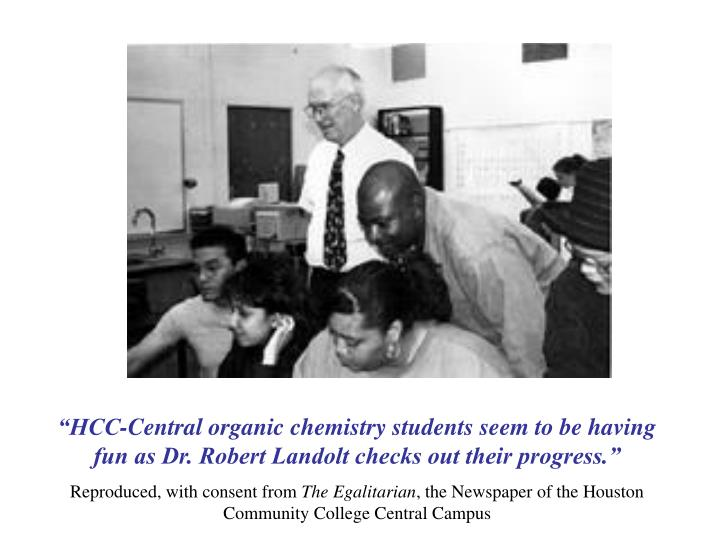 """HCC-Central organic chemistry students seem to be having fun as Dr. Robert Landolt checks out their progress."""