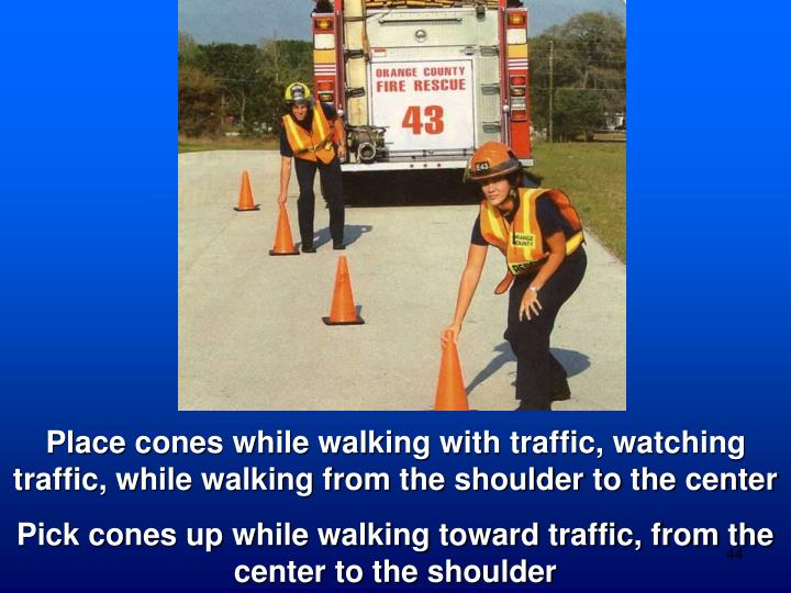 Place cones while walking with traffic, watching traffic, while walking from the shoulder to the center