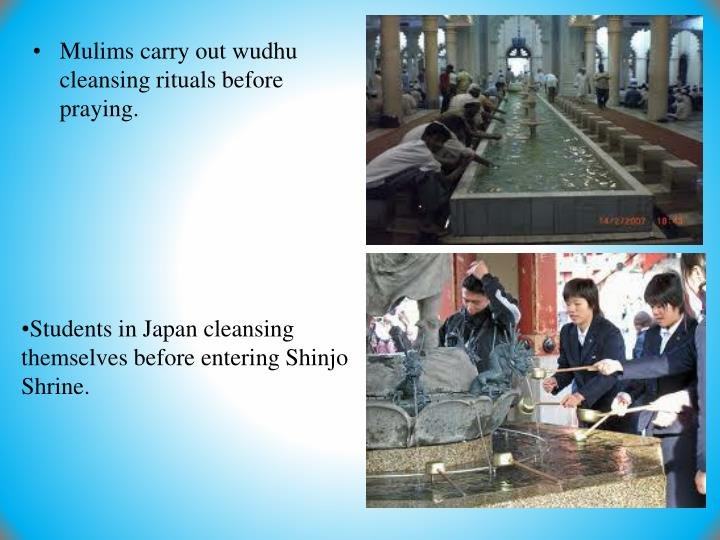 Mulims carry out wudhu cleansing rituals before praying.