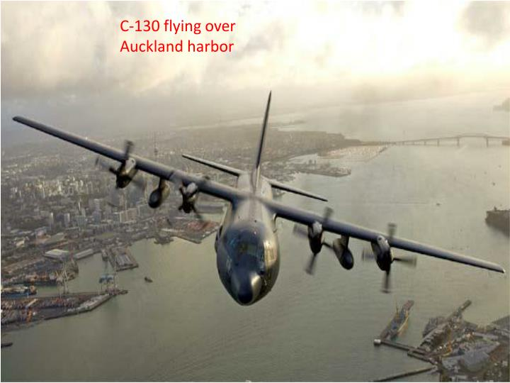 C-130 flying over Auckland harbor