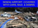 sendai airport covered with cars mud debris
