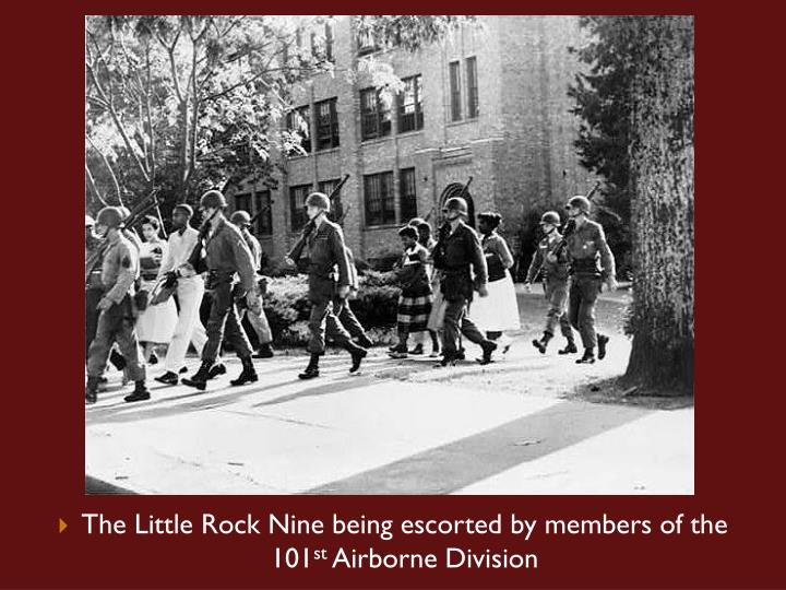 The Little Rock Nine being escorted by members of the 101