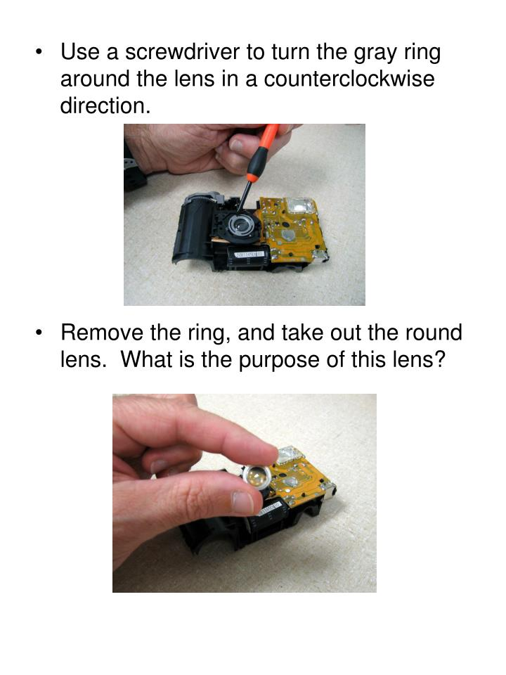 Use a screwdriver to turn the gray ring around the lens in a counterclockwise direction.