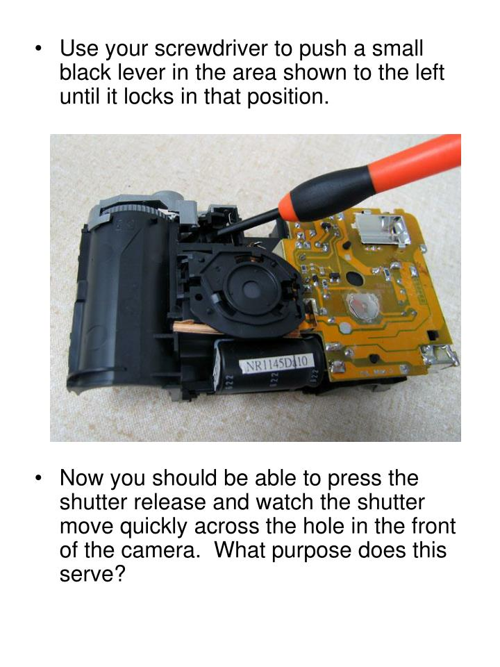 Use your screwdriver to push a small black lever in the area shown to the left until it locks in that position.