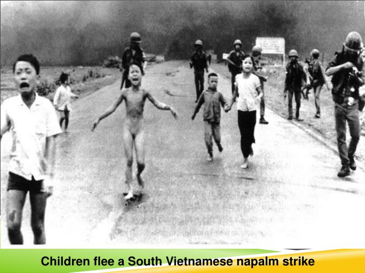 Children flee a South Vietnamese napalm strike