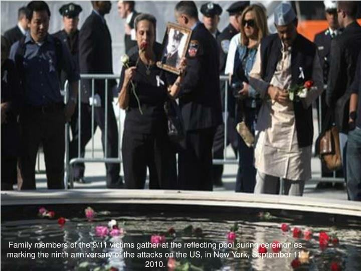 Family members of the 9/11 victims gather at the reflecting pool during ceremonies marking the ninth anniversary of the attacks on the US, in New York, September 11, 2010.