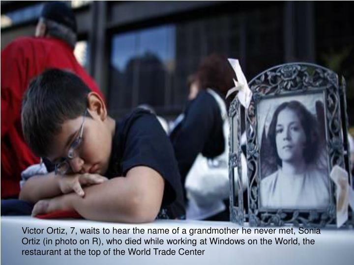 Victor Ortiz, 7, waits to hear the name of a grandmother he never met, Sonia Ortiz (in photo on R), who died while working at Windows on the World, the restaurant at the top of the World Trade Center