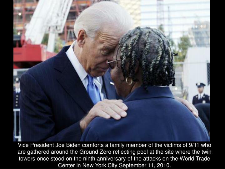 Vice President Joe Biden comforts a family member of the victims of 9/11 who are gathered around the Ground Zero reflecting pool at the site where the twin towers once stood on the ninth anniversary of the attacks on the World Trade Center in New York City September 11, 2010.