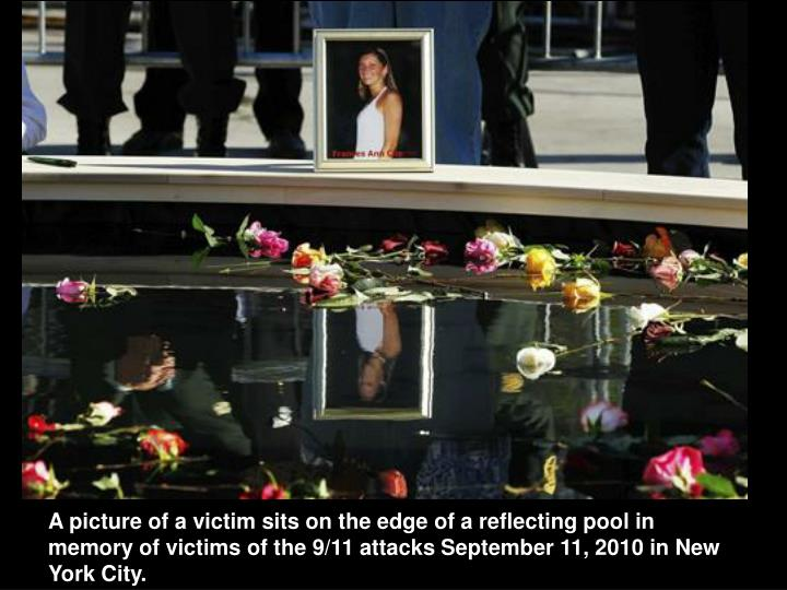 A picture of a victim sits on the edge of a reflecting pool in memory of victims of the 9/11 attacks September 11, 2010 in New York City.