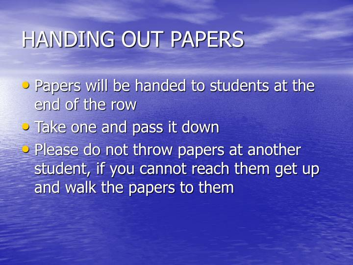 HANDING OUT PAPERS