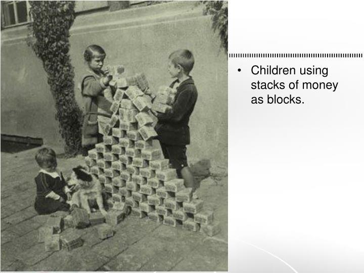 Children using stacks of money as blocks.