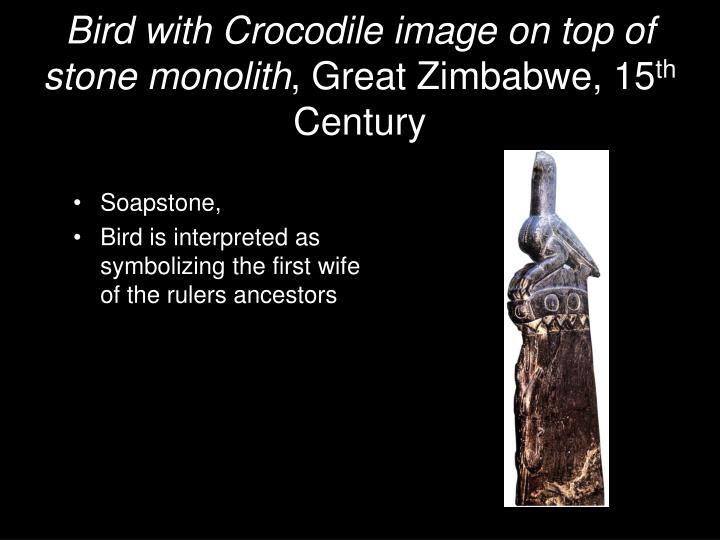 Bird with Crocodile image on top of stone monolith