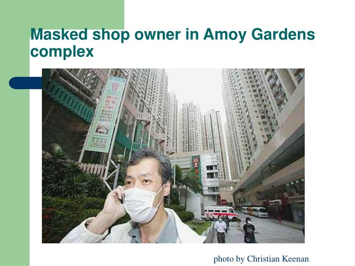 Masked shop owner in Amoy Gardens complex