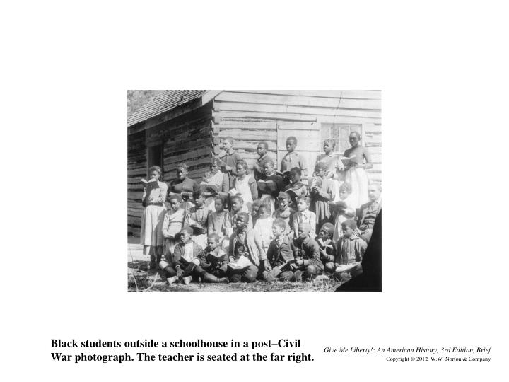 Black students outside a schoolhouse in a post–Civil