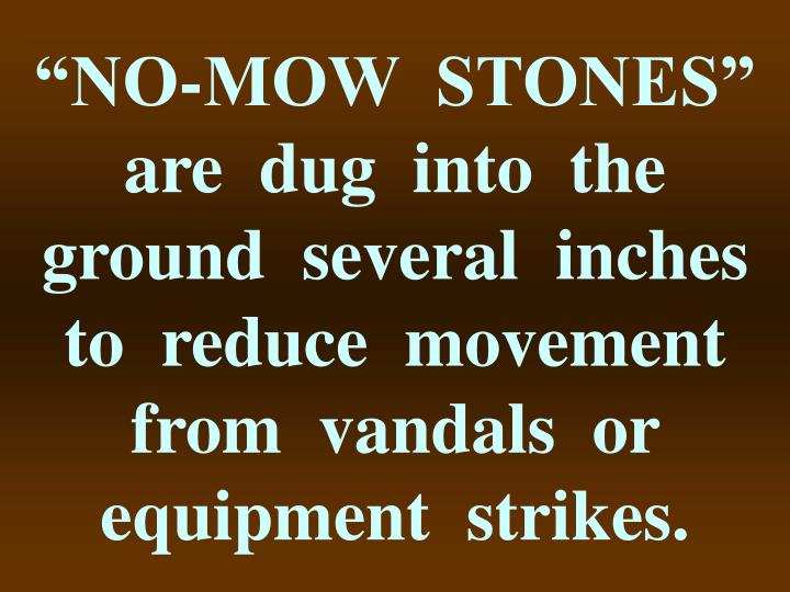 """NO-MOW  STONES""  are  dug  into  the  ground  several  inches  to  reduce  movement  from  vandals  or  equipment  strikes."