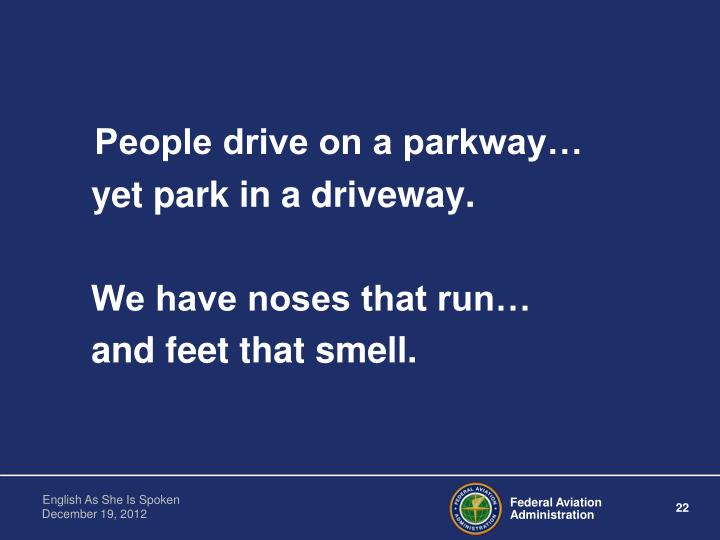 People drive on a parkway…