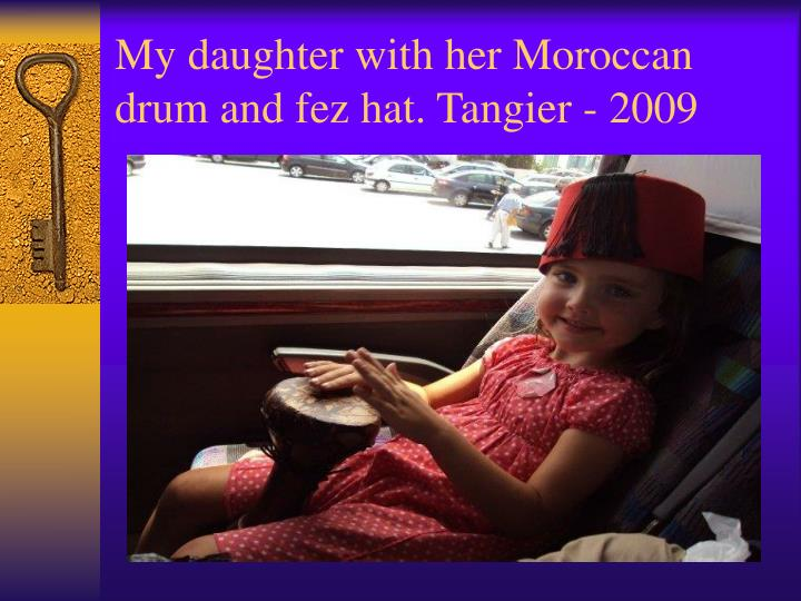 My daughter with her Moroccan drum and fez hat. Tangier - 2009