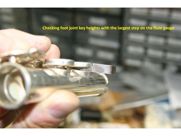Checking foot joint key heights with the largest step on the flute gauge
