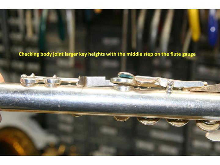 Checking body joint larger key heights with the middle step on the flute gauge