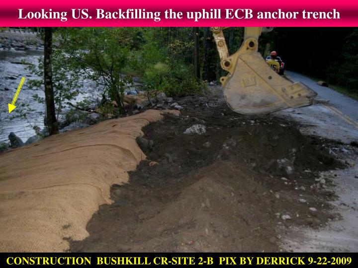 Looking US. Backfilling the uphill ECB anchor trench