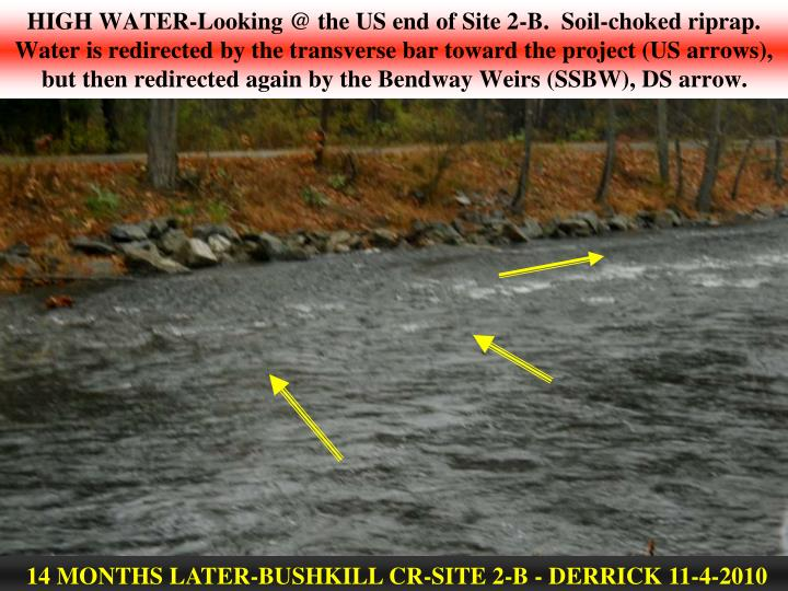 HIGH WATER-Looking @ the US end of Site 2-B.  Soil-choked riprap. Water is redirected by the transverse bar toward the project (US arrows), but then redirected again by the Bendway Weirs (SSBW), DS arrow.
