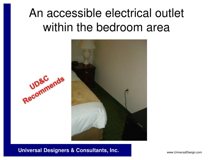 An accessible electrical outlet within the bedroom area