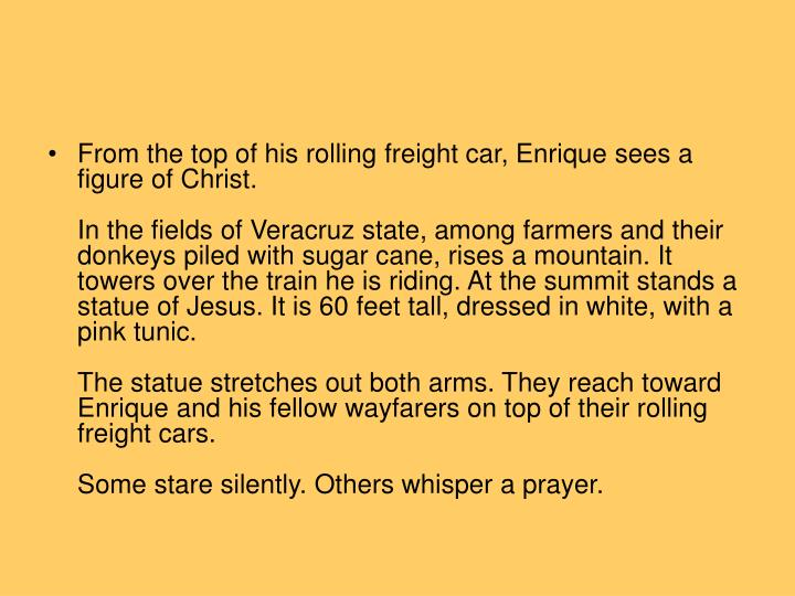 From the top of his rolling freight car, Enrique sees a figure of Christ.