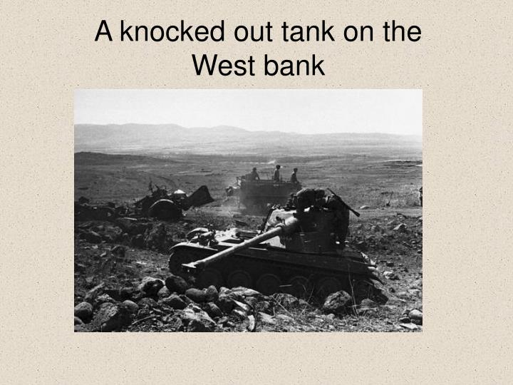 A knocked out tank on the West bank