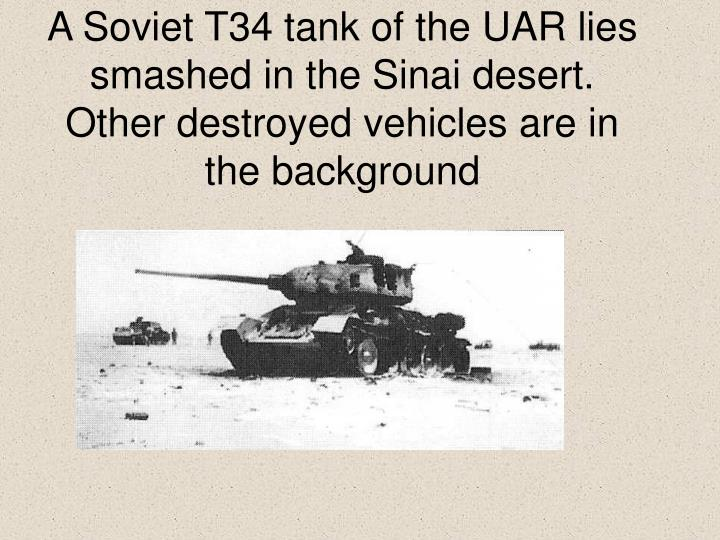A Soviet T34 tank of the UAR lies smashed in the Sinai desert. Other destroyed vehicles are in the background