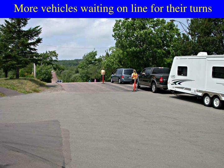 More vehicles waiting on line for their turns