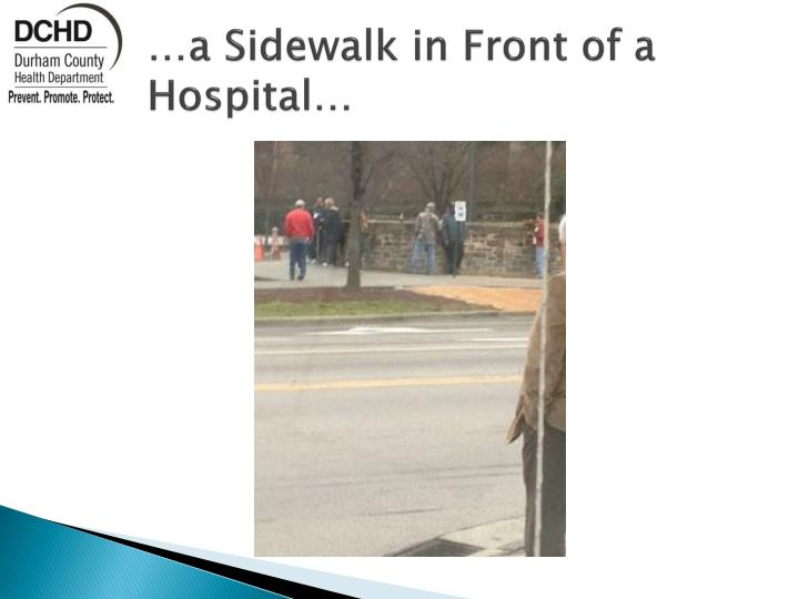 …a Sidewalk in Front of a Hospital…