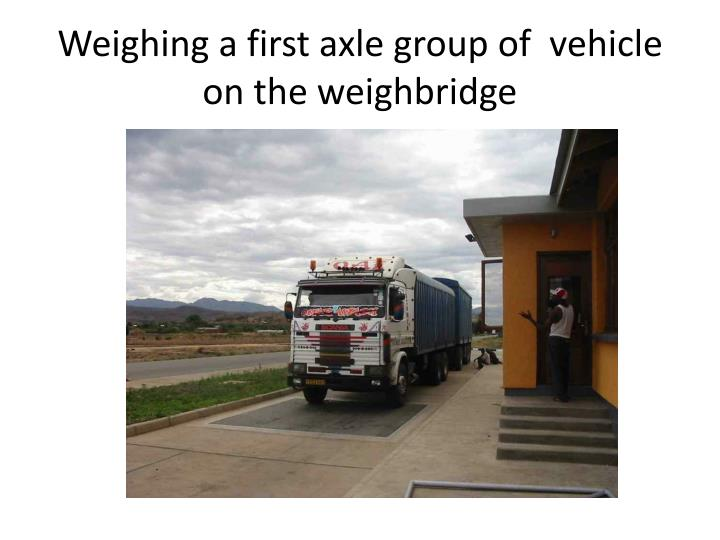 Weighing a first axle group of  vehicle on the weighbridge