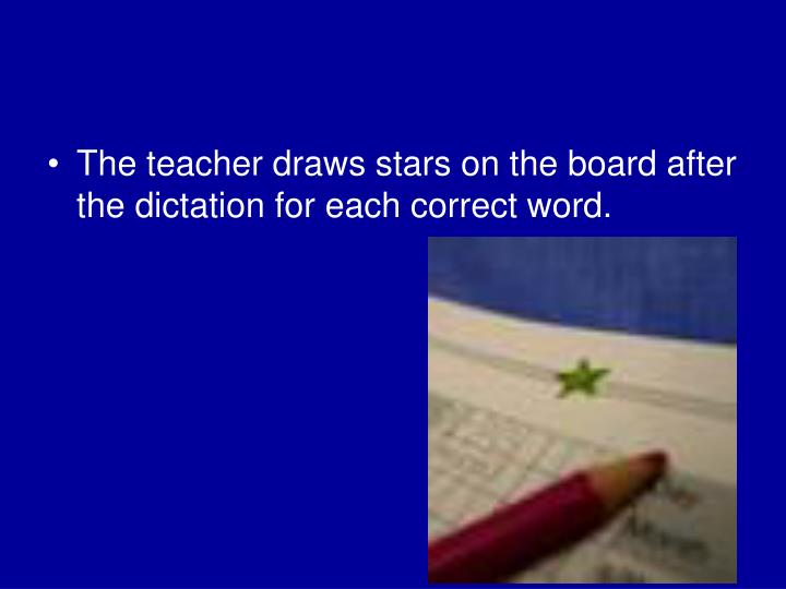 The teacher draws stars on the board after the dictation for each correct word.