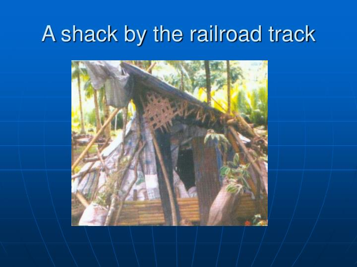 A shack by the railroad track