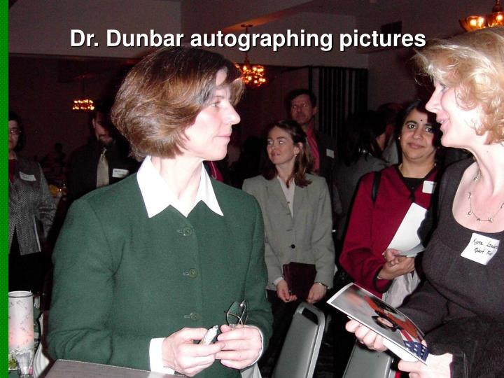 Dr. Dunbar autographing pictures