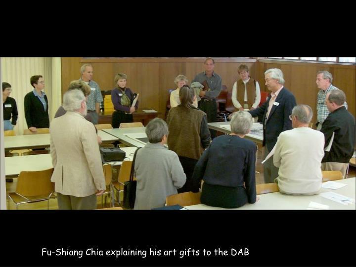 Fu-Shiang Chia explaining his art gifts to the DAB